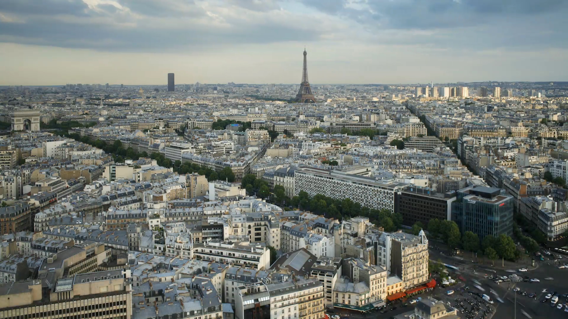 View of Paris' streets, buildings and the Eiffel Tower from up high.