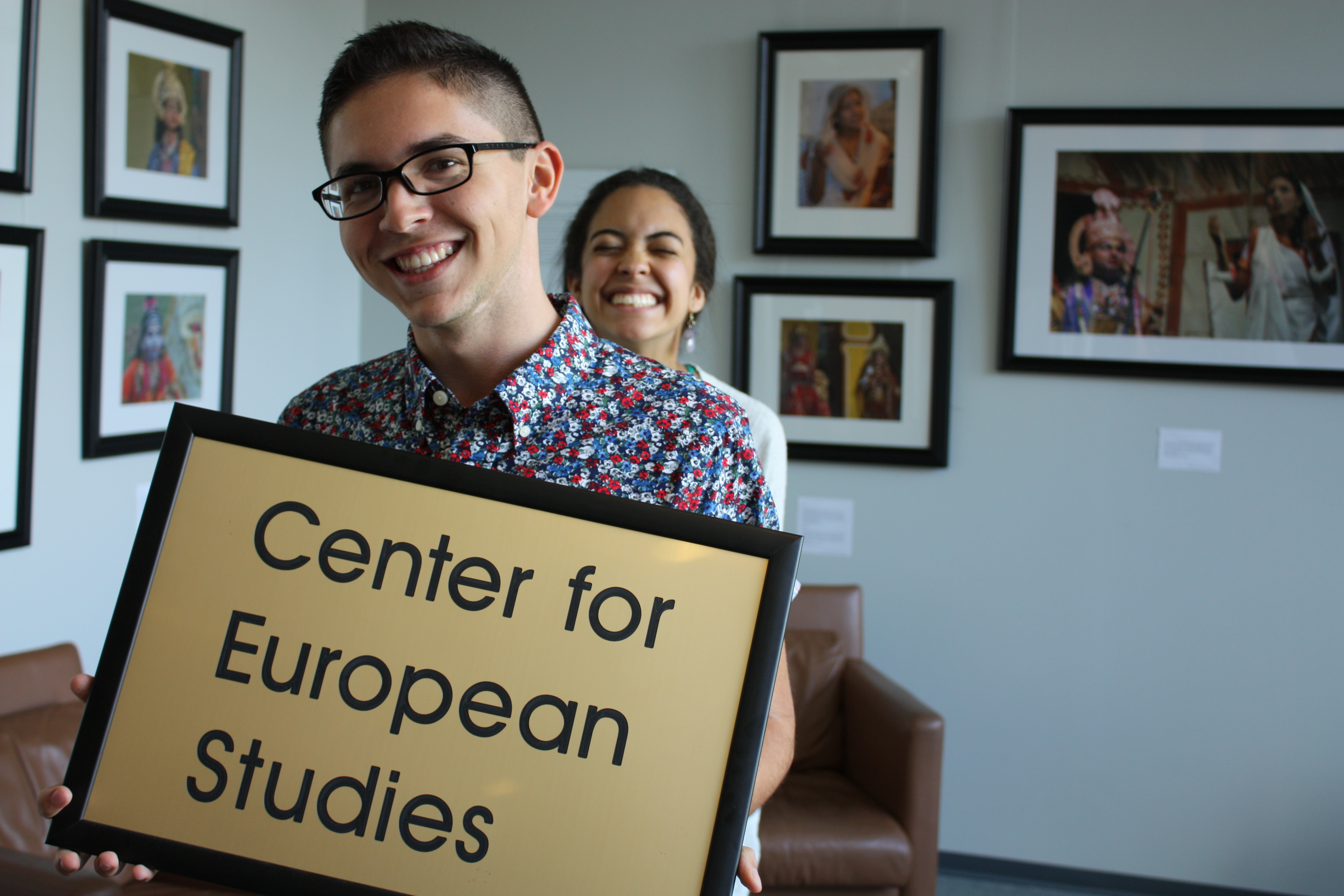 A student holds a picture with the Center for European Studies on it.