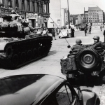 U.S. tanks face an East German water cannon at Checkpoint Charlie, 1961. Wikimedia Commons: U.S. Army