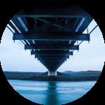 Decorative image of a bridge over still water.