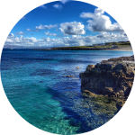 Decorative image of a sunny cliff and seashore, sea and sky in Ireland.