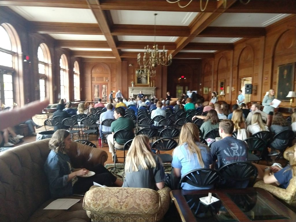 An audience listens to a panel in Graham Memorial building.