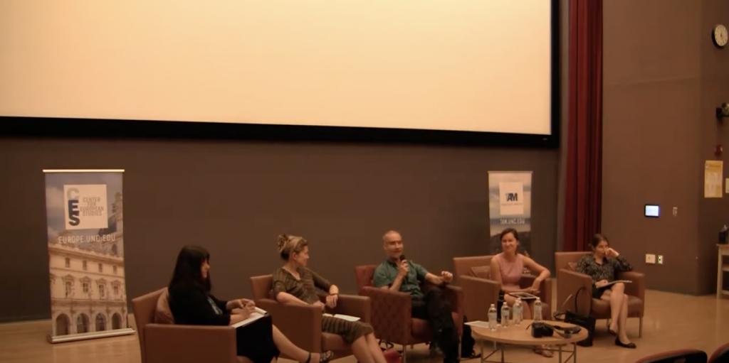 Grigore Pop-Eleches speaks on the panel.