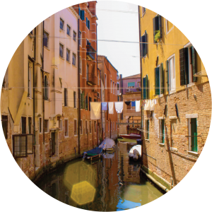 Decorative photo of canal and buildings in Italy.