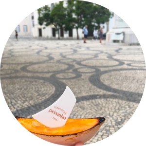 Decorative photo of Portuguese gondola-shaped confection and courtyard with decorative stonework.