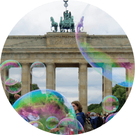 Bubbles floating over a crowd in front of the Berliner Tor